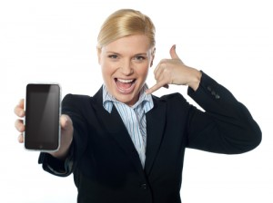 Saleswoman displaying iphone to camera, based on touch-pad technology